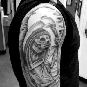 black and grey reaper tattoo