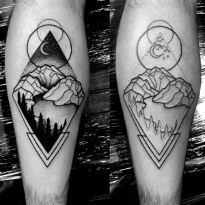 black and grey mountain pointillism tattoo