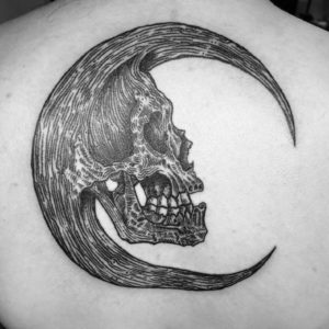 black and grey moon with skull tattoo