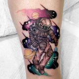 astronaut watercolor tattoo