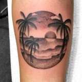 black and grey island tattoo