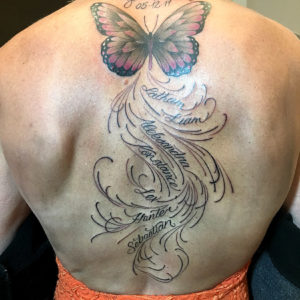 butterfly with lettering tattoo