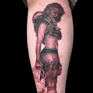 football pinup tattoo