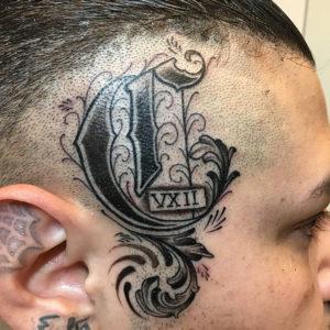 letter on head tattoo