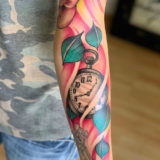 stopwatch and leaves tattoo