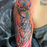 skeleton hand burning candle tattoo
