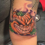 angry pumpkin tattoo
