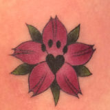 red flower paw print tattoo