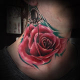 red rose and spider tattoo