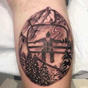 ski lift black and grey tattoo