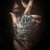 skeleton skull tattoo on hand