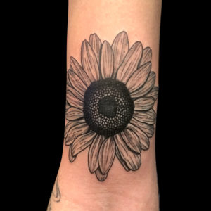 linework sunflower tattoo on arm