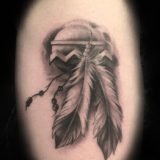 black and grey feathers tattoo