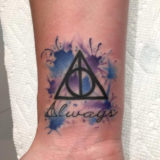 watercolor deathly hollows triangle tattoo