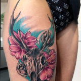 antler and floral tattoo