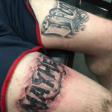 black and grey lettering tattoo