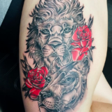 lion and roses tattoo
