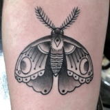 black and grey moth tattoo
