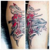 rebel riding shark tattoo
