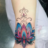 color lotus wrist tattoo