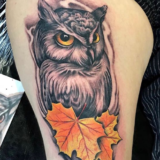 owl with fall leaf tattoo