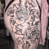 floral linework hip tattoo