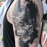 skull and trees tattoos