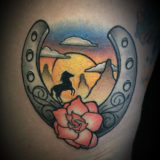 horseshoe western scene tattoo