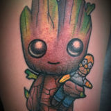 groot with bart simpson tattoo