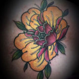 yellow flower tattoo