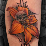 Lilly and skull tattoo
