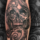 black and grey skull and snake tattoo