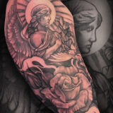 black and grey rose and angel tattoo