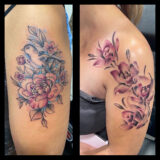 pink and blue floral arm tattoos