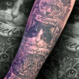 black and grey three cat tattoo