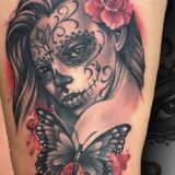 de los muertos girl and butterfly tattoo