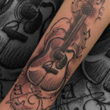 guitar and music note tattoo