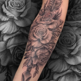 black and grey rose and arrow tattoo
