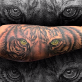 tiger face with color eyes tattoo