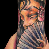 color female with fan tattoo