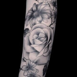 black and grey floral tattoo