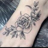 black and grey stipple rose tattoo
