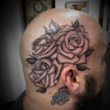black & grey roses on the head tattoo