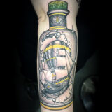 ship in a absinthe bottle tattoo