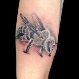 bee tattoo on forearm