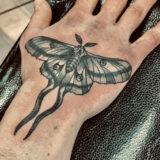 moth tattoo on wrist