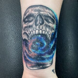 cosmic skull tattoo